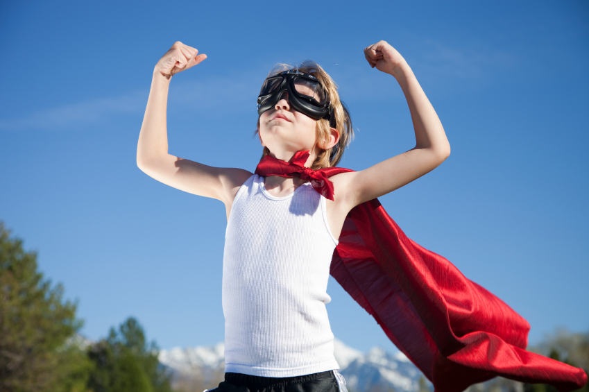 Child showing confidence dressed as a super hero
