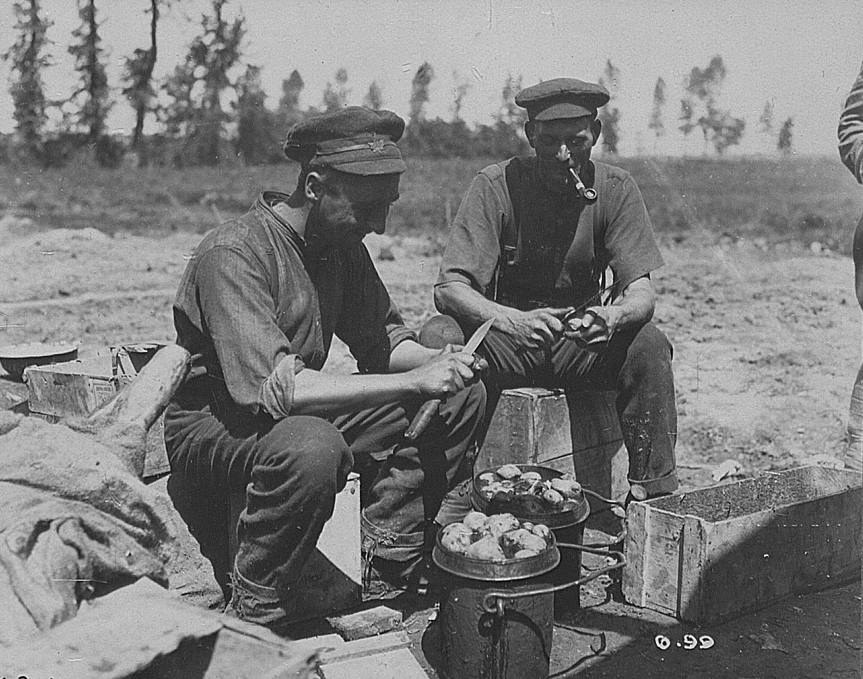 Canadian soldiers peeling potatoes - Canadian Official War Photographs